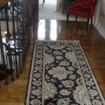 BLACK BLACK ORIENTAL RUNNER OVER HARDWOOD FLOORING LEAWOOD KANSAS