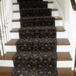 BLACK CUSTOM STAIR RUNNER INSTALLED OVER A HARD WOOD STEP OVERLAND PARK KANSAS