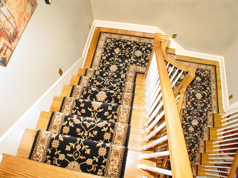 Black Oriental Wool Stair Runner Installed On 2 Landings