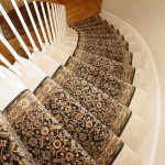 BLACK TRADITIONAL STAIR RUNNER INSTALLED ON CURVED STAIR CASE OVERLAND PARK KS