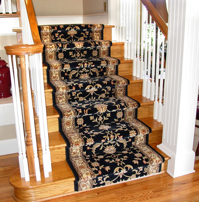 Black Wool Stair Runner Installed On Light Hardwood