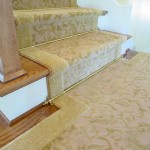 CUSTOM WOOL STAIR RUUNER WITH RODS AND LANDING INSTALLED IN LEAWOOD KANSAS