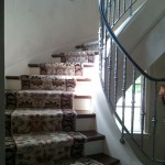 HAND KNOTTED WOOL STAIR RUNNER INSTALLED ON CURVED STAIRCASE JOHNSON COUNTY KANSAS