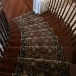 RED AND BLACK HAND KNOTTED ORIENTAL RUNNER INSTALLED ON STAIRS OLATHE KANSAS