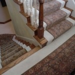STAIR RUNNER'S WITH MATCHING ORIENTAL RUG FOR LANDING INSTALLED OVER CARPET