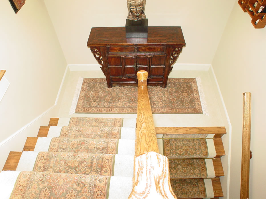 Green Oriental Stair Runner With Matching Area Rug On Landing