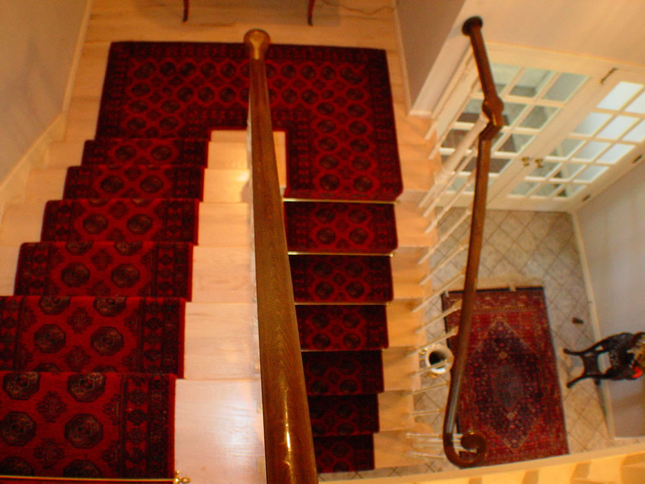 Red Traditoinal Stair Runner Installed Continuously On